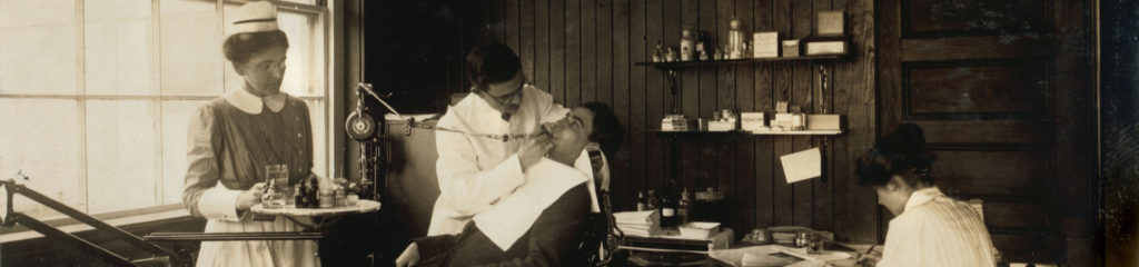 old black and white photo of a dentist's office