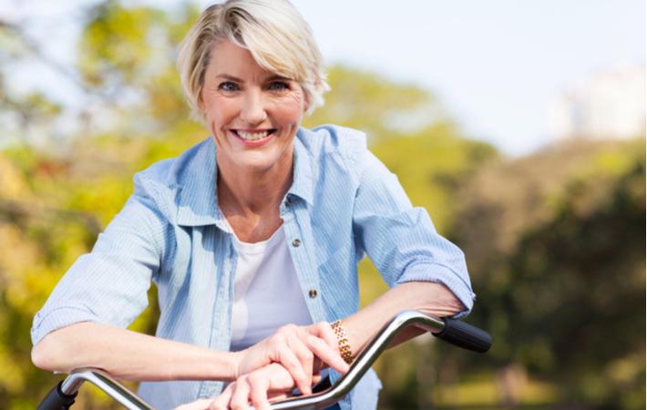 woman smiling on bike