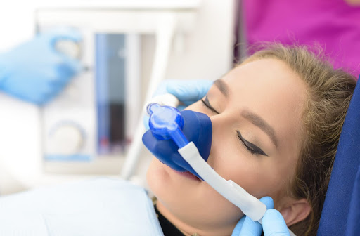 Relaxed woman undergoing a sedation dentistry procedure