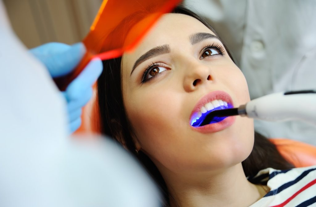 A young woman during her dental filling appointment